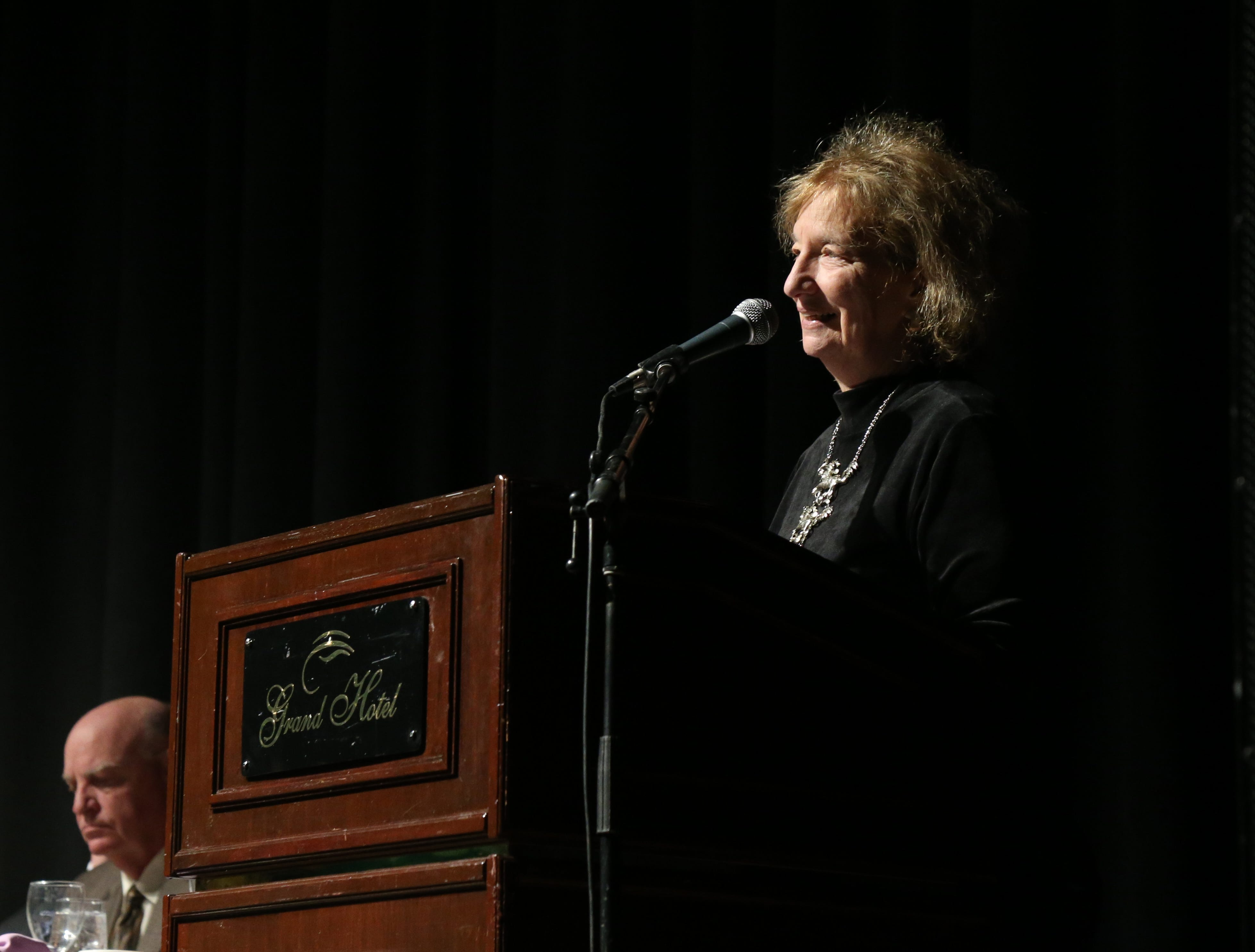 Betsy Kopstein Stuts, president of the board of directors at the Catharine Street Community Center makes opening remarks during the Martin Luther King Jr. Breakfast in the City of Poughkeepsie on January 25, 2019.