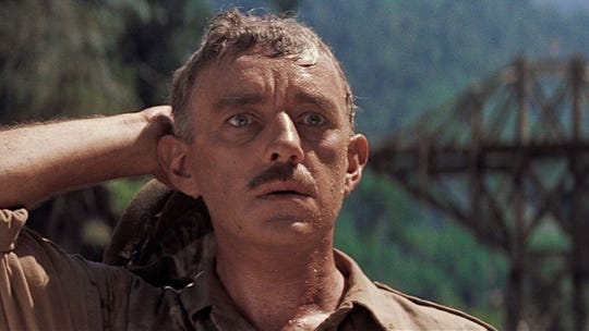 "Alec Guinness is shown in a scene from ""The Bridge on the River Kwai."""