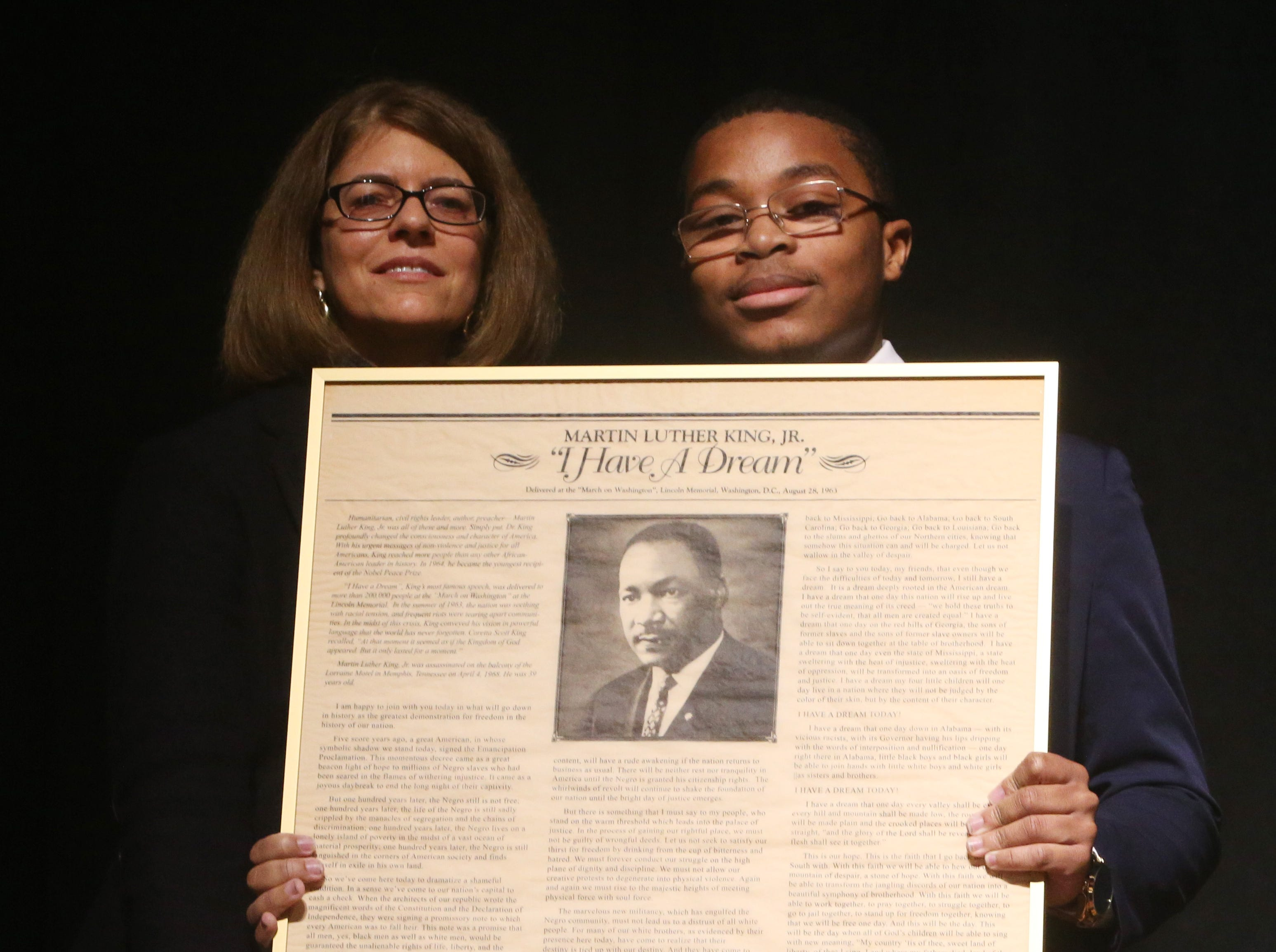 Youth honoree Richmond N. Addae receives his award from Trish Prunty of the Roosevelt Institute during the Martin Luther King Jr. Breakfast in the City of Poughkeepsie on January 25, 2019.