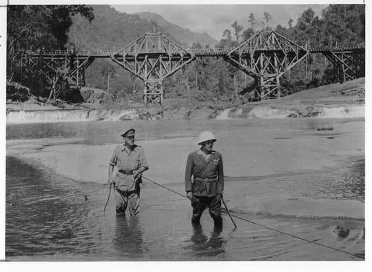 "Alec Guinness, left, and Sessue Hayakawa are shown in a scene from ""The Bridge on the River Kwai."""