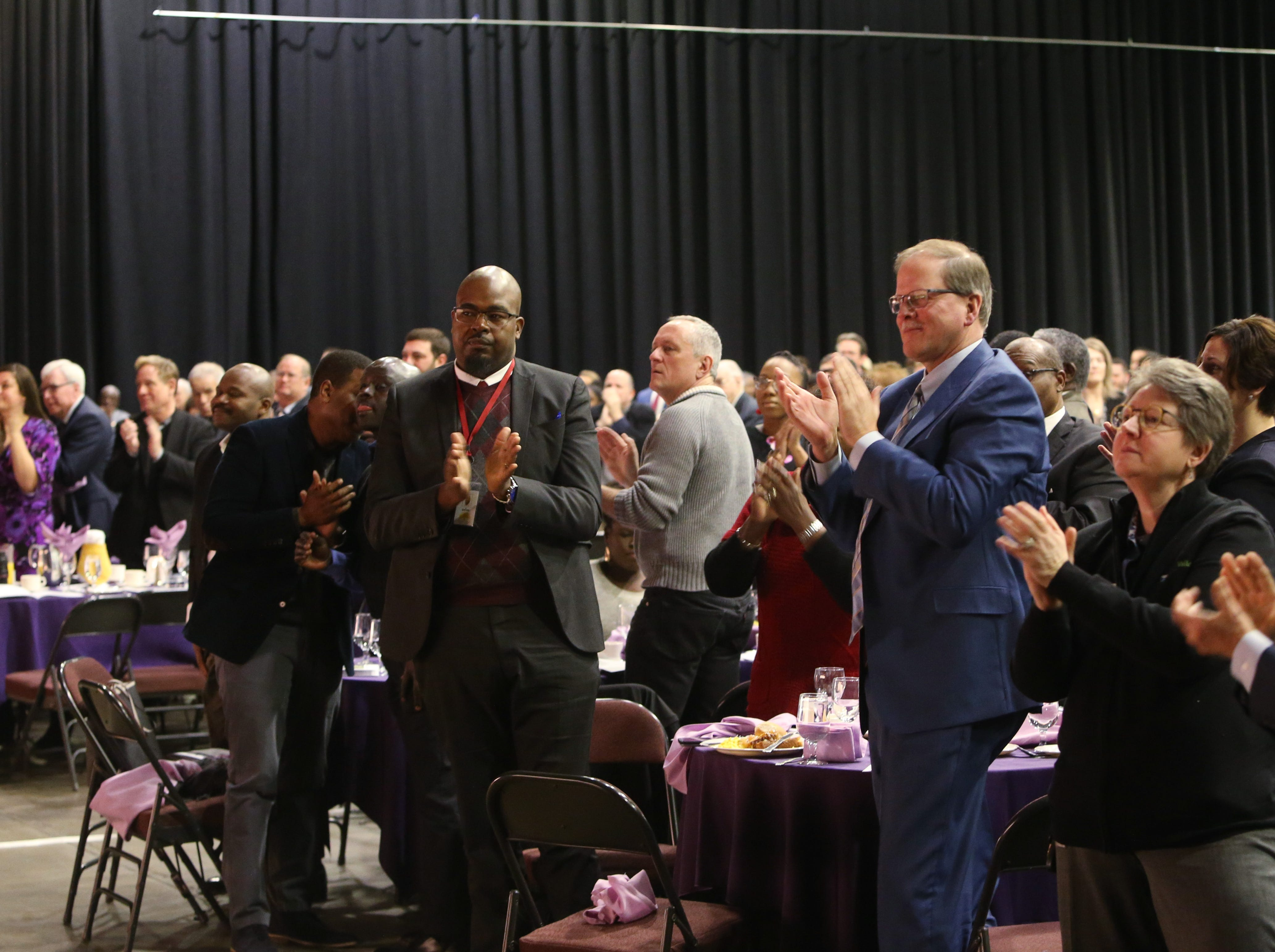 Attendees applaud youth honoree Sashawna A. Isaacs during the Martin Luther King Jr. Breakfast in the City of Poughkeepsie on January 25, 2019.