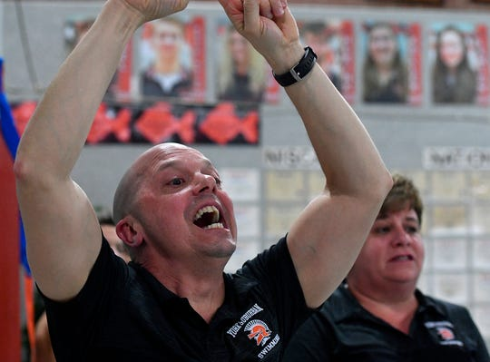 York Suburban coach Ever Gonzalez reacts as Hannah Lawon and Megan Lonergan take first and second respectively in the 500 free event, Thursday, January 24, 2019.