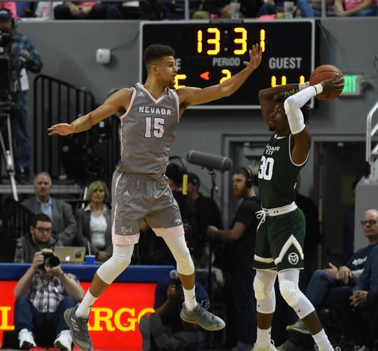 Nevada's Trey Porter defends against Colorado State during the Wolf Pack's 40-point win last week.