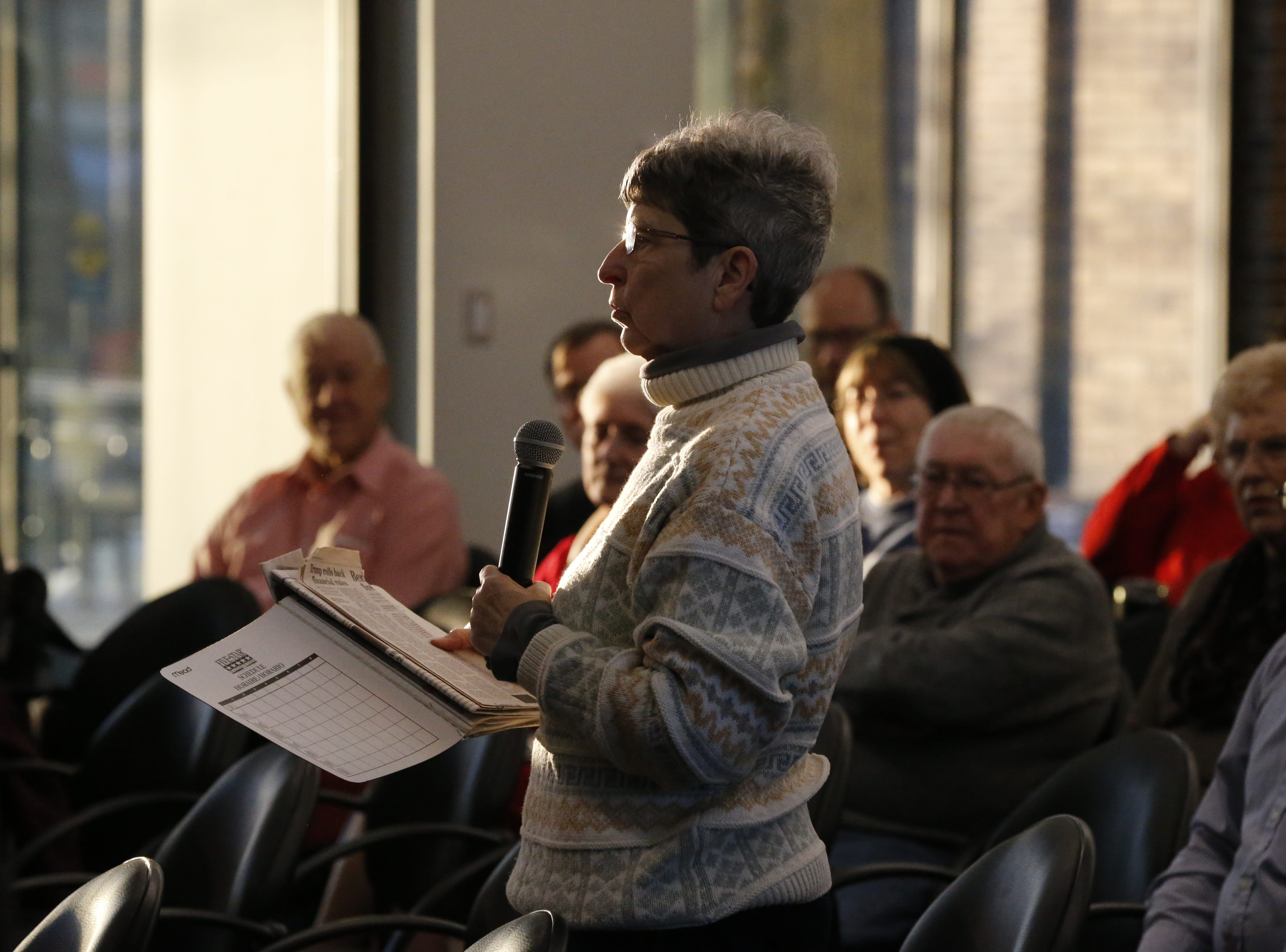 An audience member asks a question during Friday's Legislative Forum in the lobby of Whitewater Hall on the IU East campus in Richmond.