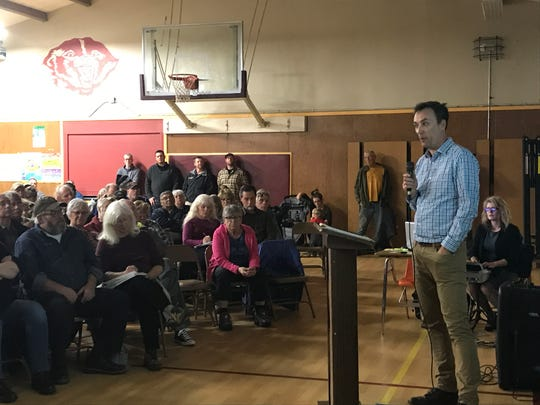 Fountain Wind project developer Scott Kringen addresses a full Montgomery Creek Elementary School gym at Thursday's meeting.
