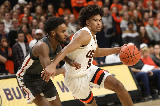 Oregon State's Ethan Thompson slides around Washington State's Ahmed Ali during the first half of an NCAA college basketball game in Corvallis, Ore., Thursday, Jan. 24, 2019.