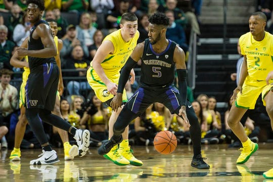 Jan 24, 2019; Eugene, OR, USA; Washington Huskies guard Jaylen Nowell (5) dribbles the ball past Oregon Ducks guard Payton Pritchard (3) during the first half at Matthew Knight Arena. Mandatory Credit: Troy Wayrynen-USA TODAY Sports