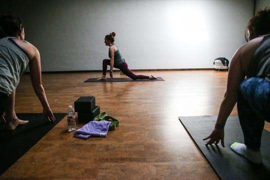Brea Burke leads a yoga class Friday, Jan. 18, 2019, at Yoga San Angelo.