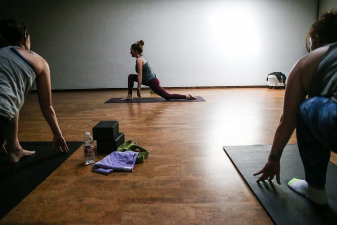 Brea Burke leads a yoga class Friday, Jan. 18, 2019, at Yoga San Angelo.