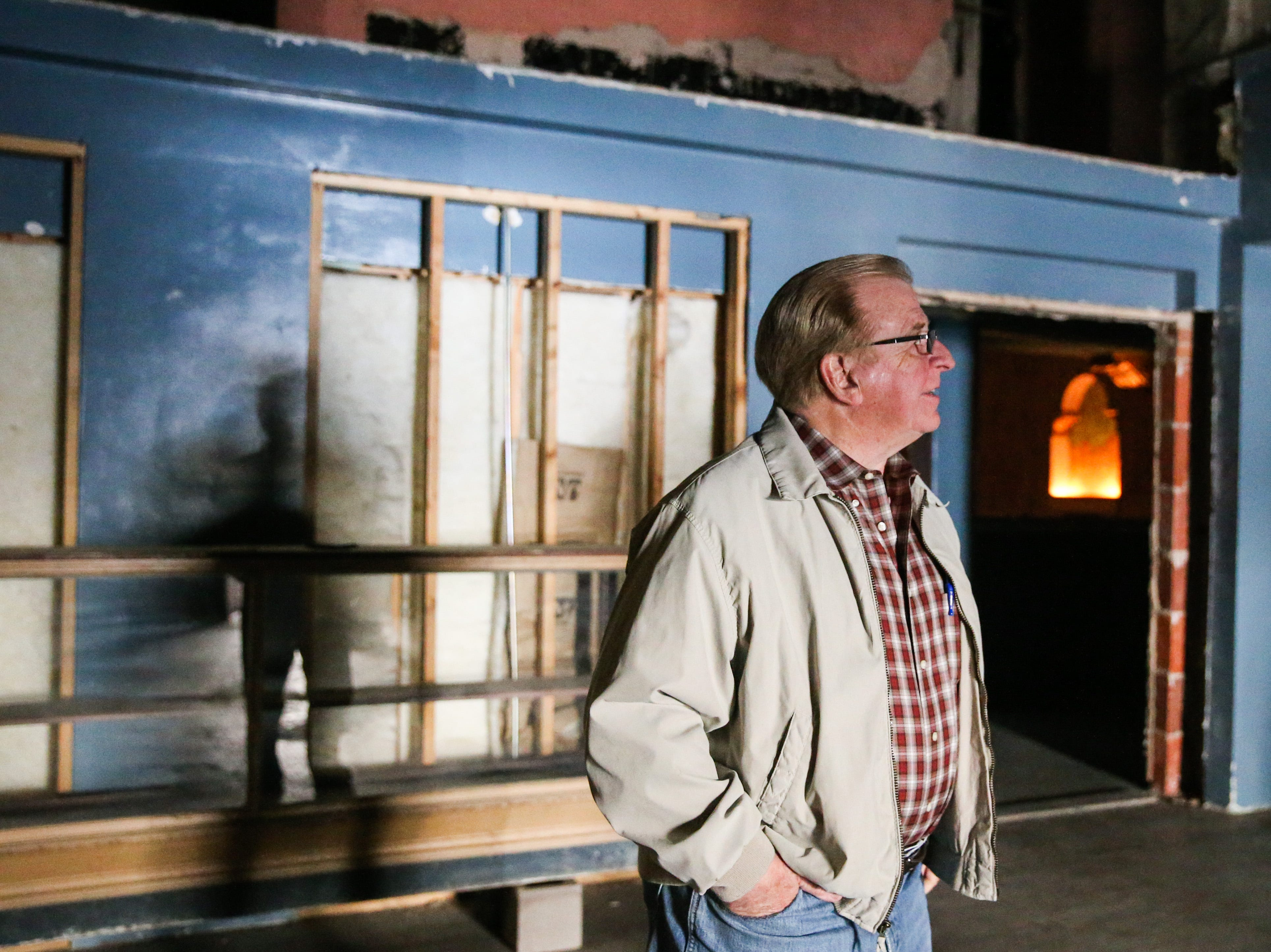 Lee Pfluger walks around the lobby Thursday, Jan. 24, 2019, at former Texas Theatre. Pfluger purchased the building in 1998.