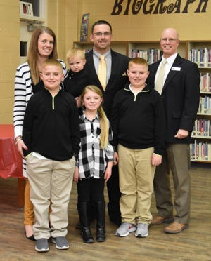 John Contrucci and his family are shown with Junction ISD Superintendent Mike Carter after Contrucci was officially named Junction's new head football coach and athletic director.