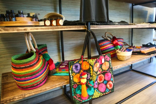 Colorful items are for sale in the lobby of Yoga San Angelo.