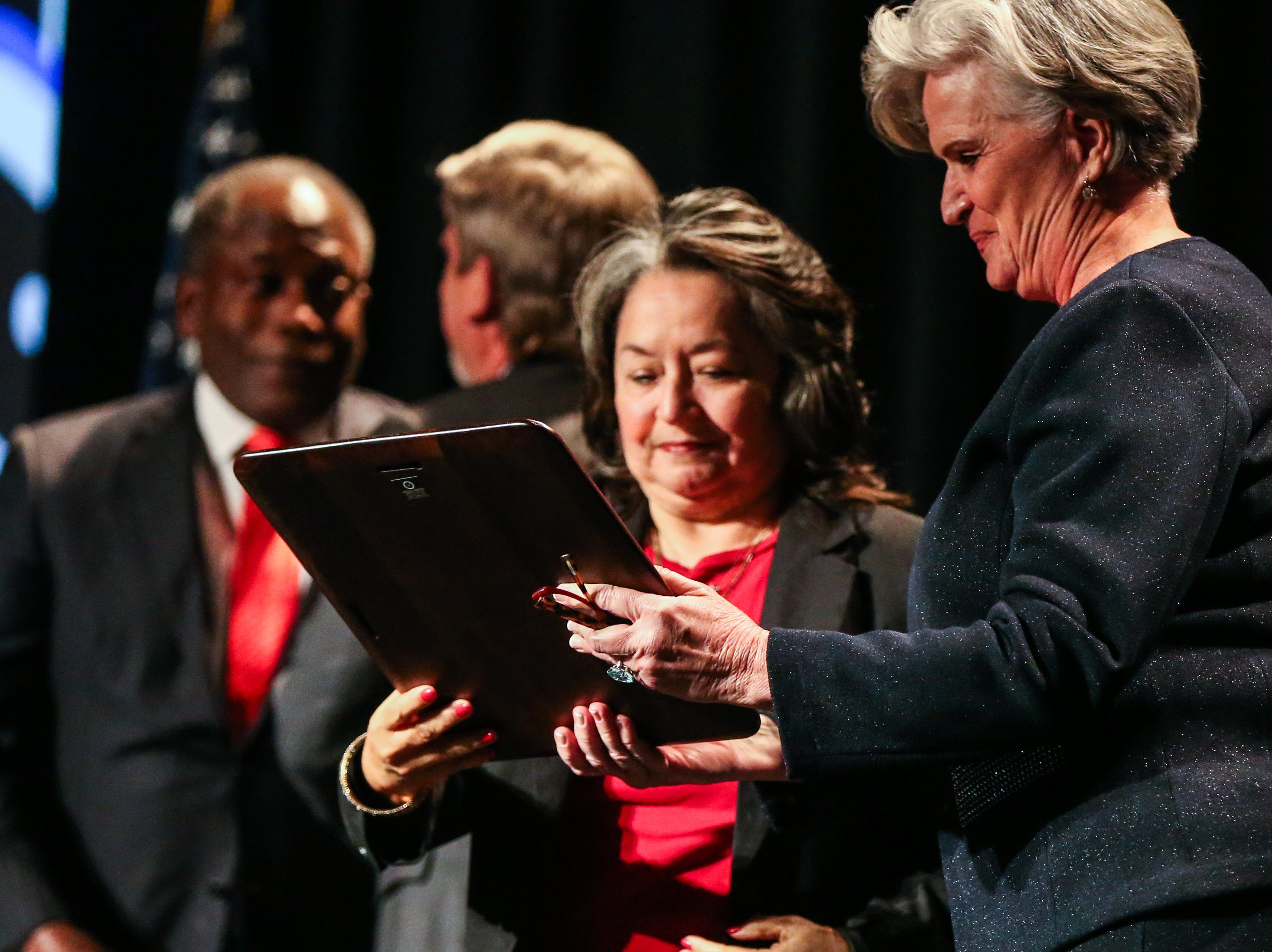 Sheryl Pfluger hands Maria Hawkins the Citizen of the Year award received along with her husband, Ronnie Hawkins, during the San Angelo Chamber of Commerce Annual Banquet Thursday, Jan. 24, 2019, at McNease Convention Center.