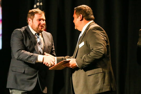 Jordan Burrell receives the Educator of the Year Award during the San Angelo Chamber of Commerce Annual Banquet Thursday, Jan. 24, 2019, at McNease Convention Center.