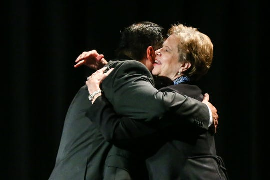 Dr. Carol Ann Bonds hugs CJ Muniz as she receives the Chairman's Award during the San Angelo Chamber of Commerce Annual Banquet Thursday, Jan. 24, 2019, at McNease Convention Center.