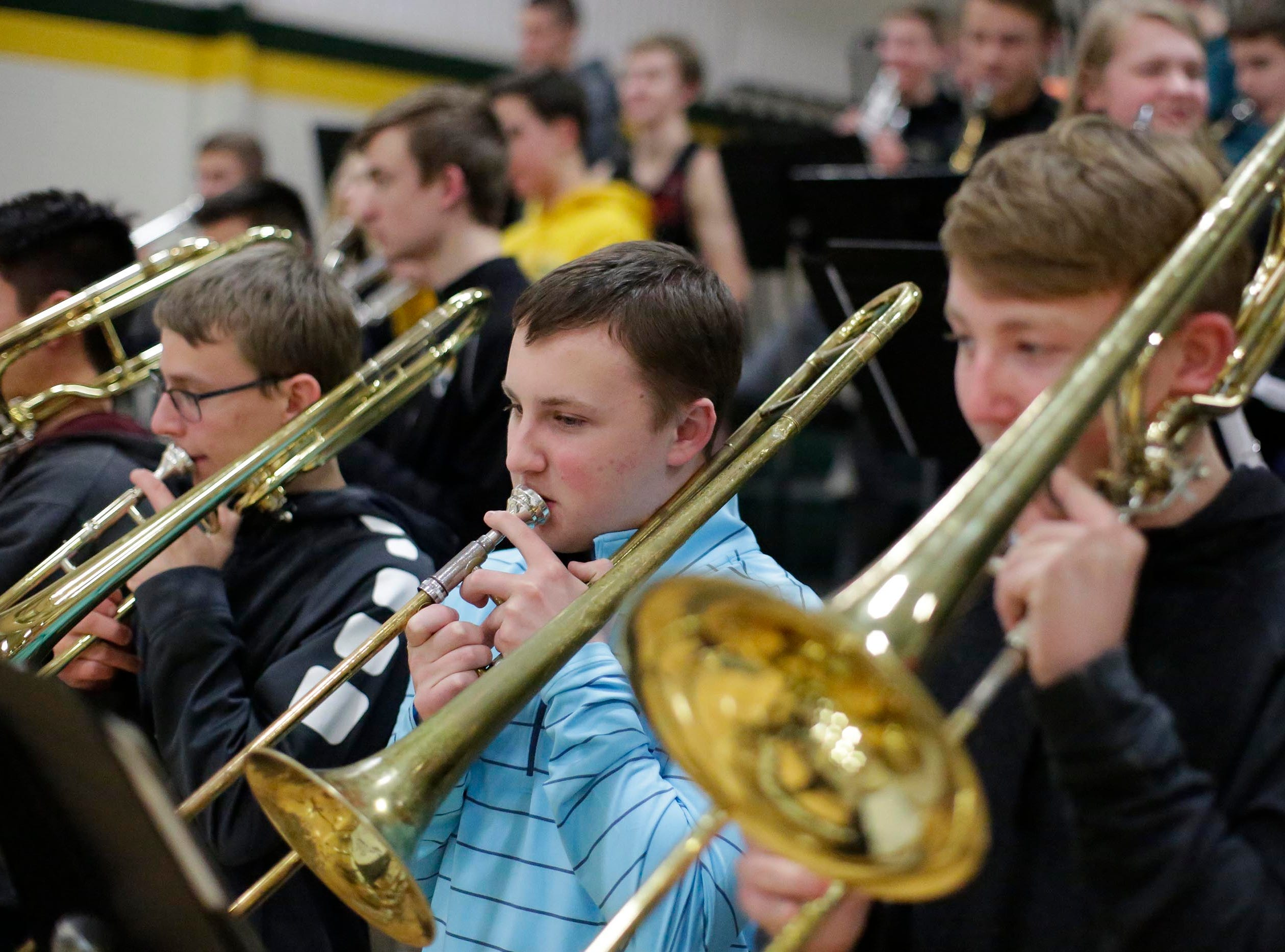 Sheboygan Lutheran's pep band trombonists perform before the game between Sheboygan Lutheran and Sheboygan Christian, Thursday, January 24, 2019, in Sheboygan, Wis.