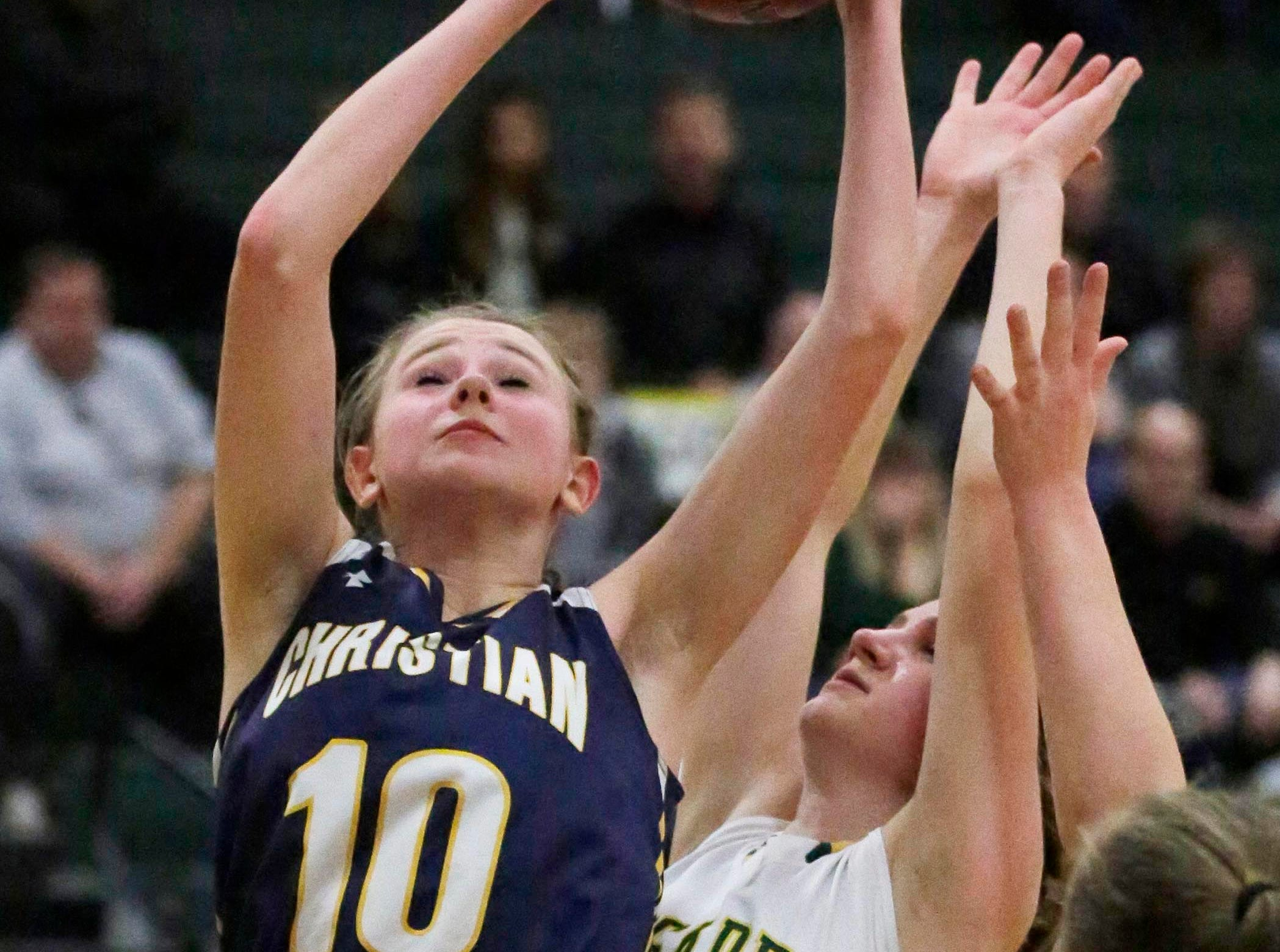 Sheboygan Christian's Maddie Zylstra (10) launches a shot against a Sheboygan Lutheran player at Lutheran, Thursday, January 24, 2019, in Sheboygan, Wis.