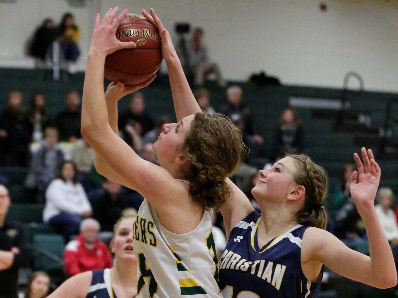 Sheboygan Lutheran's Emma Egbert (15) launches a shot against Sheboygan Christian at Lutheran, Thursday, January 24, 2019, in Sheboygan, Wis.