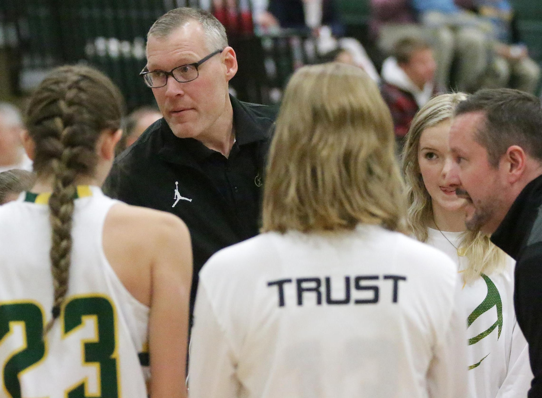 Sheboygan Lutheran coaches talk strategy with their team during a time out against Sheboygan Christian, Thursday, January 24, 2019, in Sheboygan, Wis.