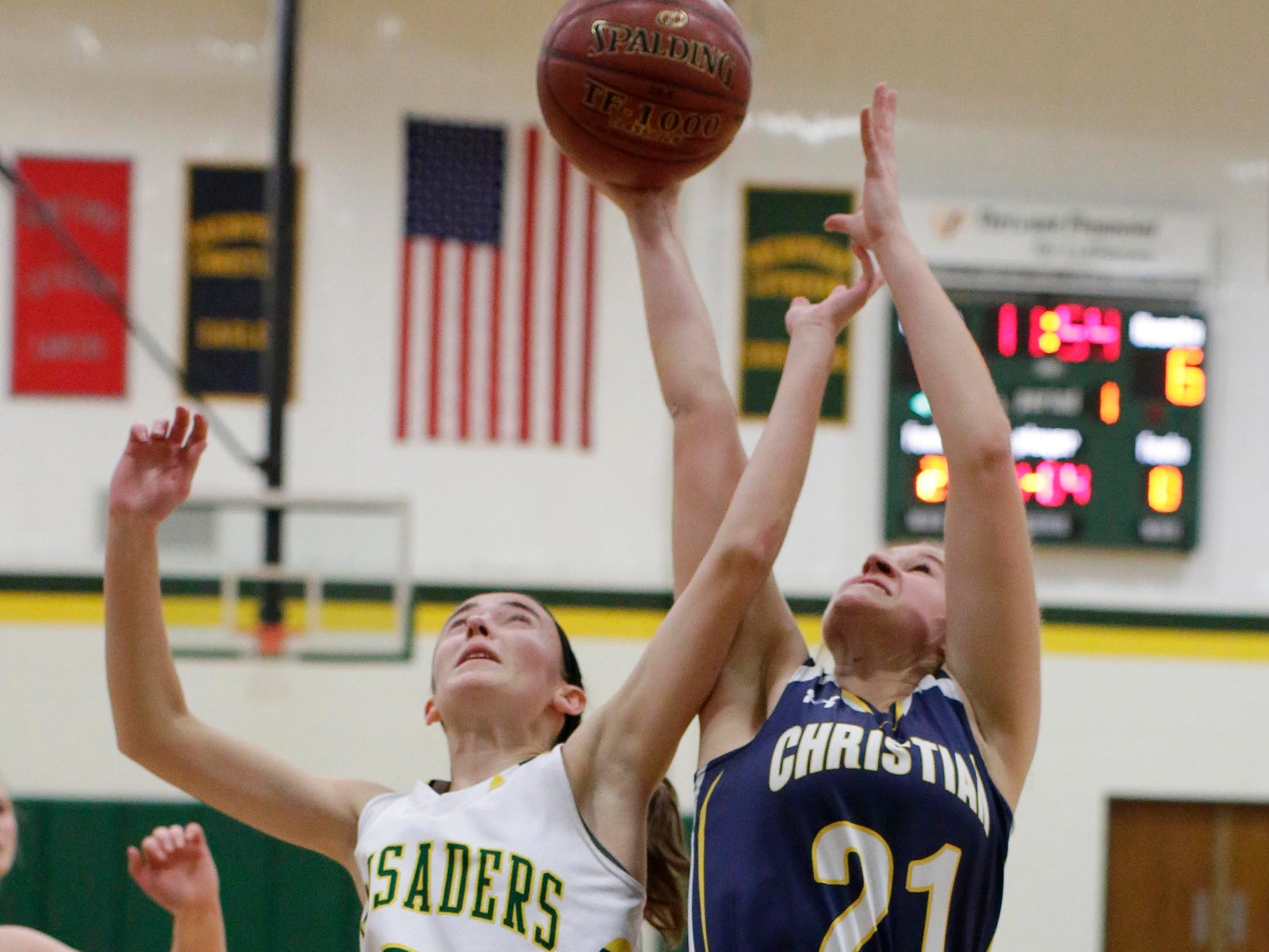 Sheboygan Lutheran's Katelyn With (5) and Sheboygan Christian's Natalie Grasse (21) battle for a rebound at Lutheran,  Thursday, January 24, 2019, in Sheboygan, Wis.
