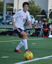 Caddo Magnet's Jackson Greenwald scored a hat trick against Benton Thursday night as the Mustangs won the district title.