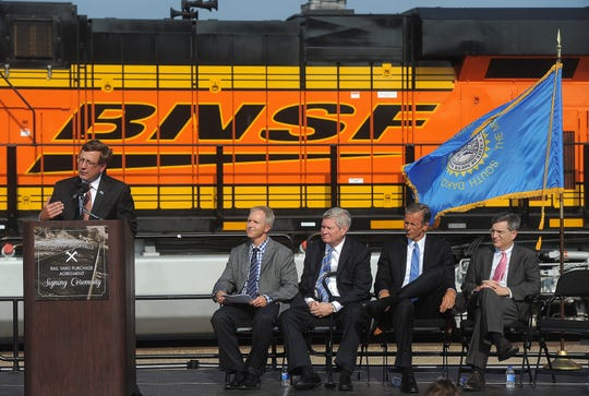 Sioux Falls mayor Mike Huether speaks during the rail yard purchase agreement signing ceremony in 2015 as director of Public Works Mark Cotter (left to right), U.S. Senator Tim Johnson, U.S. Senator John Thune and BNSF executive vice president Roger Norber listen in.