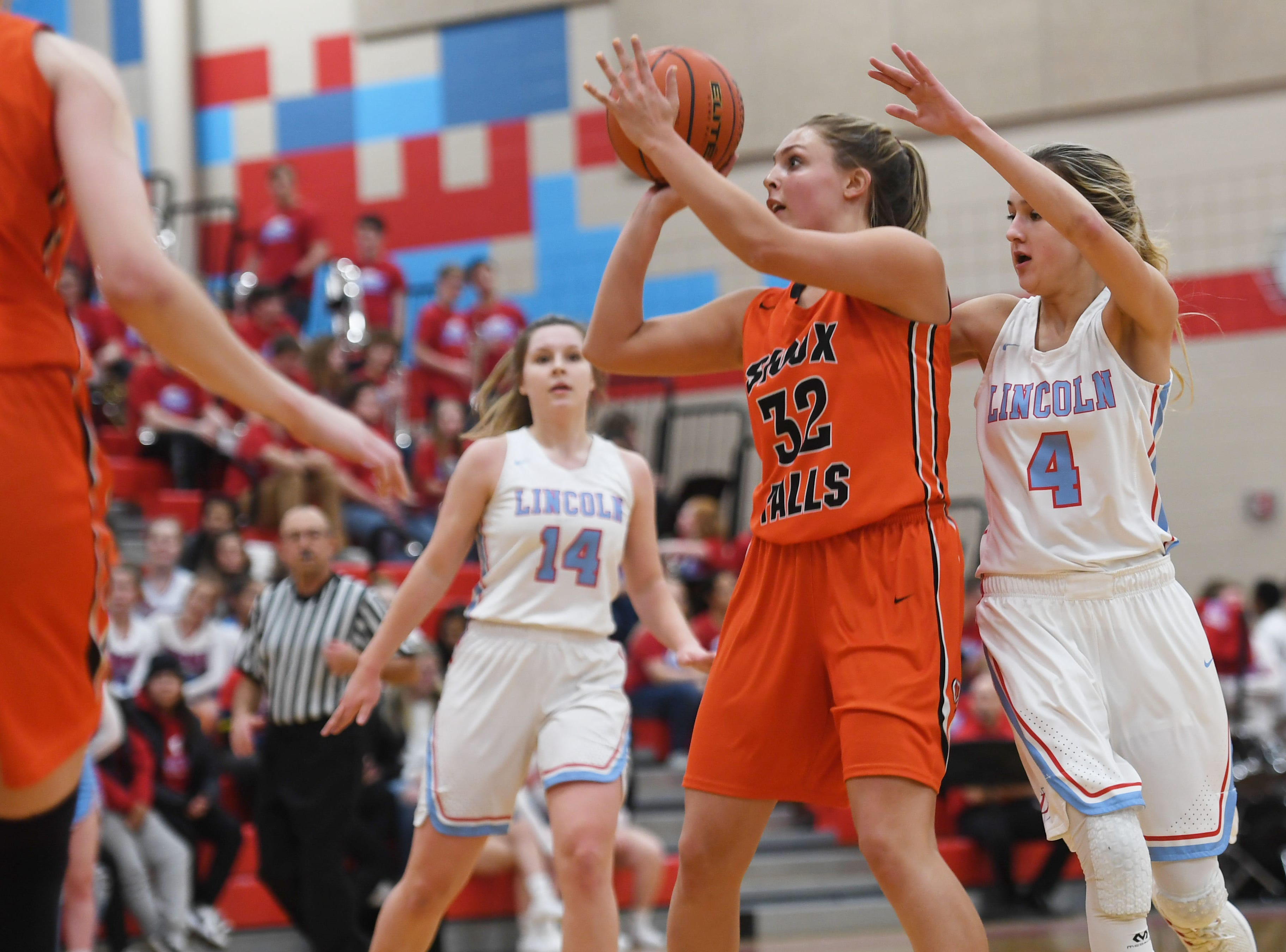 Washington's Peyton Rymerson attempts to take a shot against Lincoln defense during the game Thursday, Jan. 24, at Lincoln. Lincoln won 63-62 against Washington.