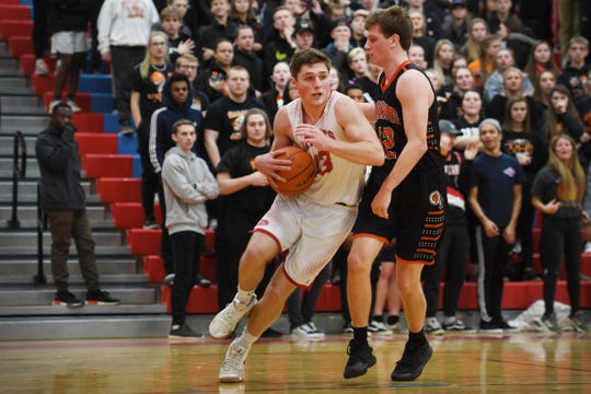 Lincoln's Jared Jaros goes against Washington defense during the game Thursday, Jan. 24, at Lincoln.