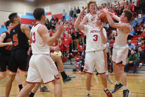 Lincoln struggles to gain control of the ball under the net during the game against Washington Thursday, Jan. 24, at Lincoln.
