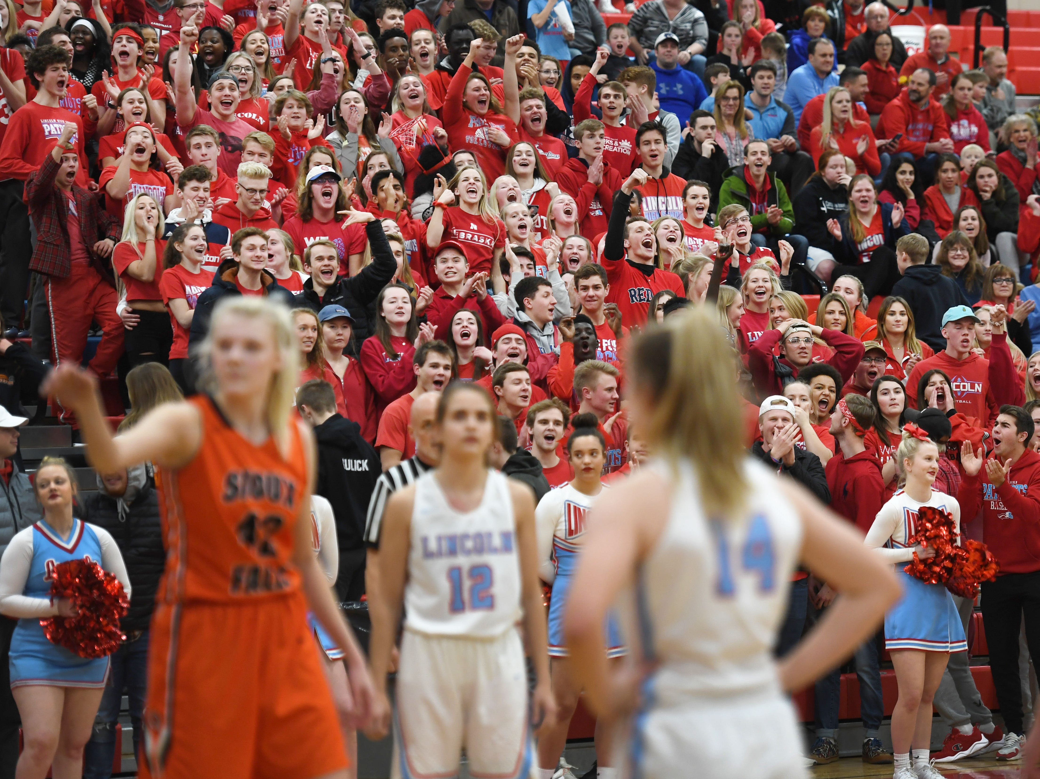 Lincoln's student section attempts to distract Washington's Rylyn Fink during a free throw Thursday, Jan. 24, at Lincoln. Lincoln won 63-62 against Washington.