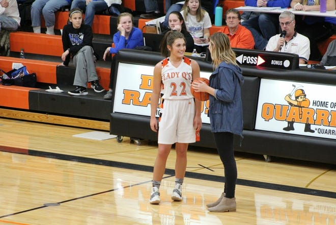 Emma Paul is congratulated by Dell Rapids coach Taylor Trohkimoinen after scoring her 1,000th career point at Dell Rapids.