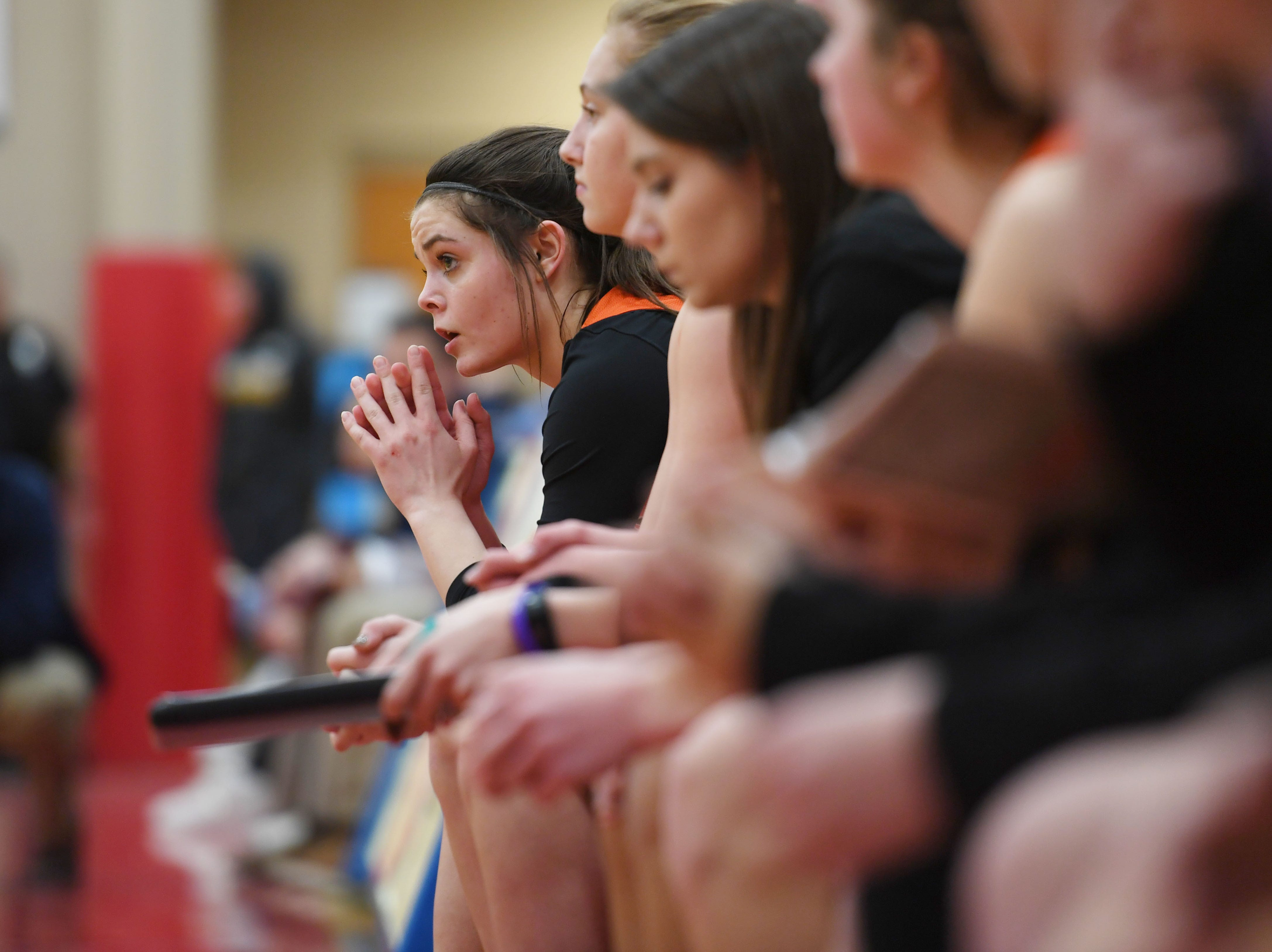 Washington players listen to a call during the game against Lincoln Thursday, Jan. 24, at Lincoln. Lincoln won 63-62 against Washington.
