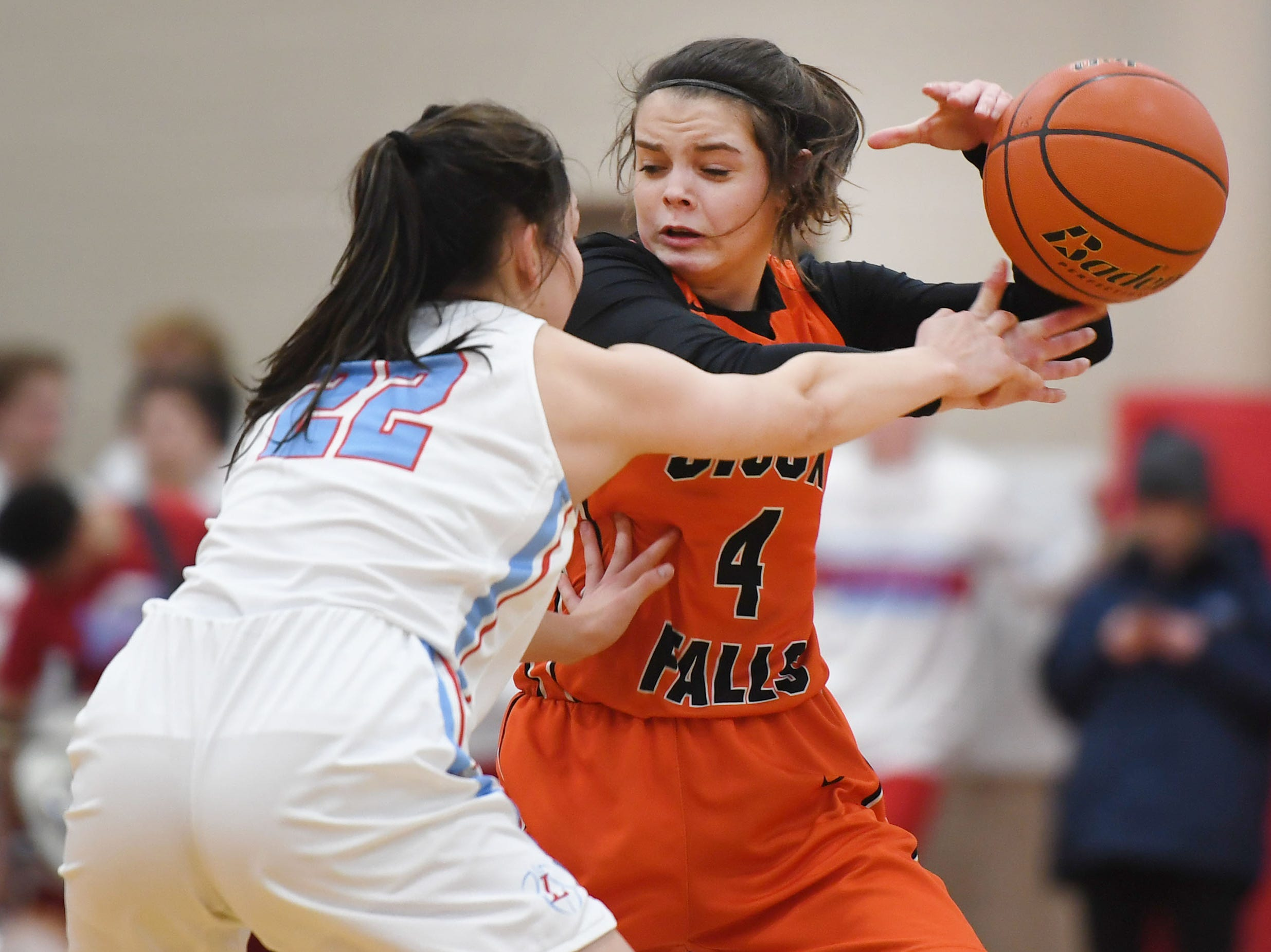 Washington's Brynn Heinert looses control of the ball against Lincoln's Brooke Brown during the game Thursday, Jan. 24, at Lincoln. Lincoln won 63-62 against Washington.