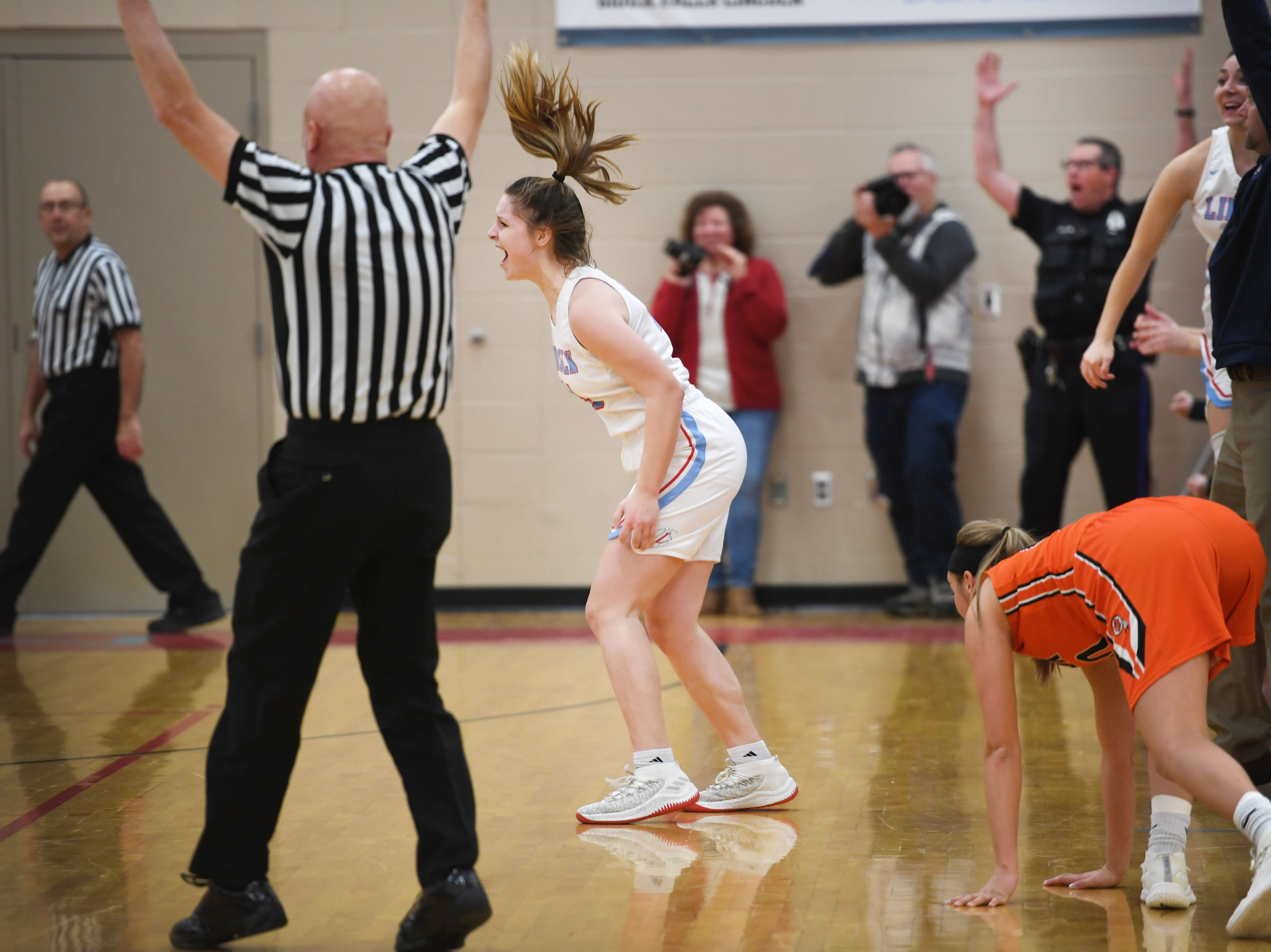 Lincoln's Emma Osmundson lets out a yell after she scores three points in the last seconds of the game against Washington Thursday, Jan. 24, at Lincoln. Lincoln won 63-62 against Washington.