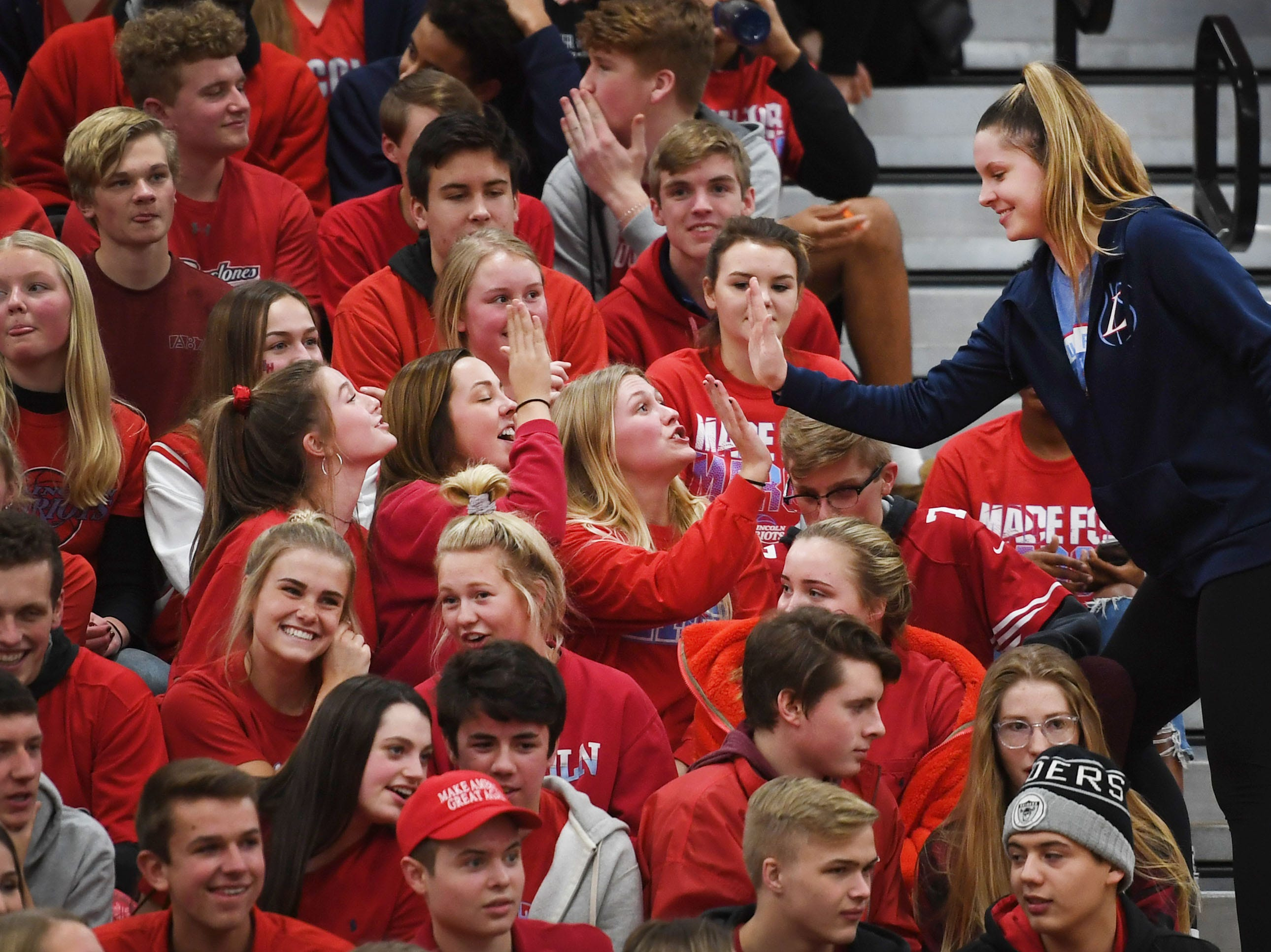 Lincoln students cheer for Emma Osmundson after the win against Washington before the boys game Thursday, Jan. 24, at Lincoln.