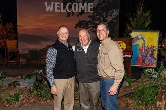 New Bass Pro Shops President Mike McDermott (right) with founder/CEO Johnny Morris (center) and outgoing President Jim Hagale (left).