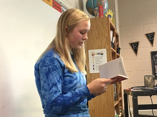 Jordan Schulz, a Fort Defiance sophomore, reads to Clymore Elementary School students Thursday. Fort Defiance athletes read in various Clymore classrooms throughout the day Thursday.