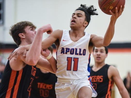 Michael Gravelle drives to the basket for Apollo during the Thursday, Jan 24, game at Tech High School in St. Cloud.