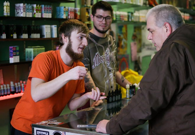 Mossity Vapes manager Tristan Davidson assists Bill Kauper, of Fremont, on Thursday, January 24, 2019, at Mossity Vapes in Stevens Point, Wis. Tork Mason/USA TODAY NETWORK-Wisconsin