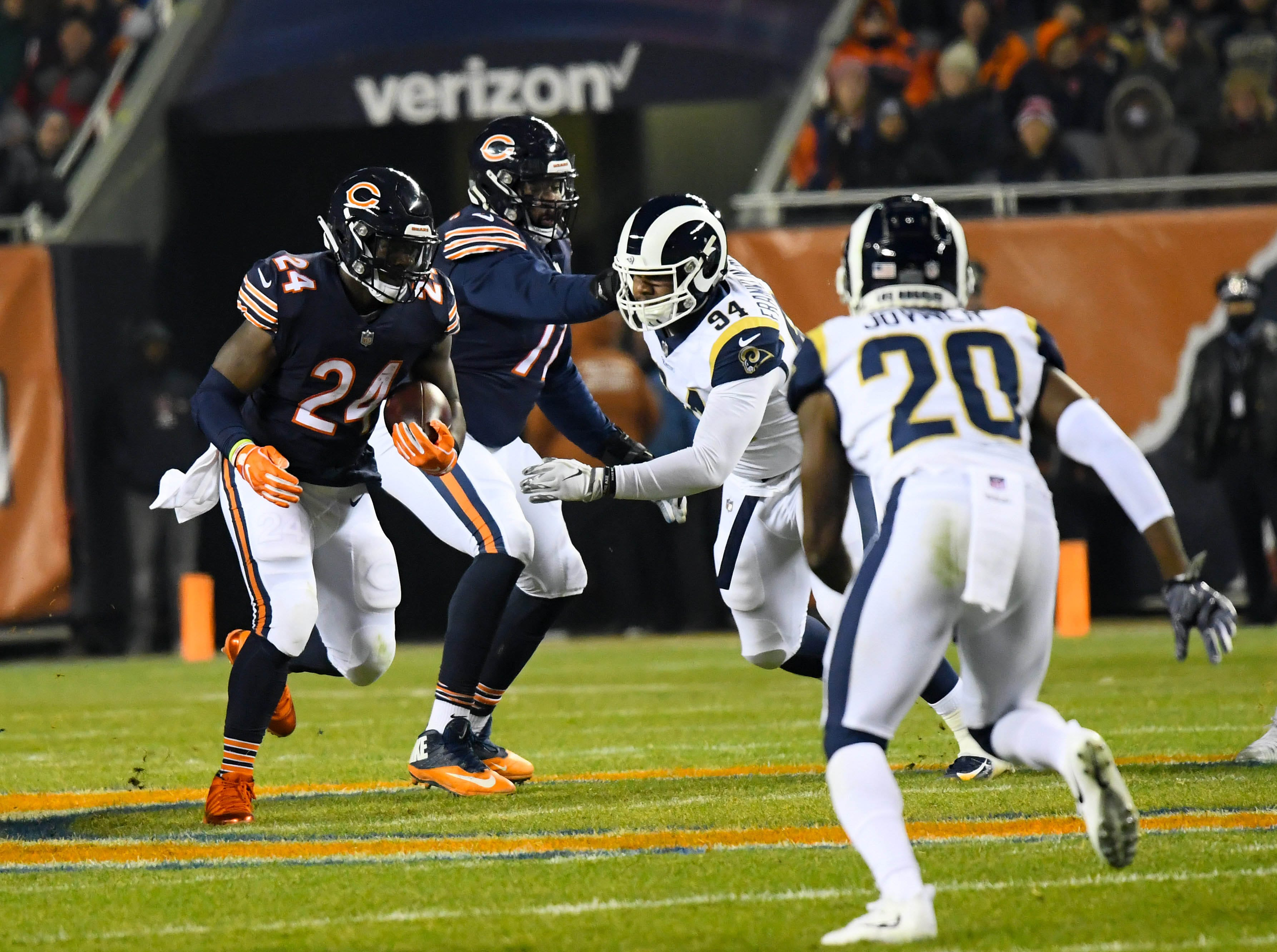 Dec 9, 2018; Chicago, IL, USA; Chicago Bears running back Jordan Howard (24) rushes the ball against Los Angeles Rams free safety Lamarcus Joyner (20) during the first quarter at Soldier Field. Mandatory Credit: Mike DiNovo-USA TODAY Sports