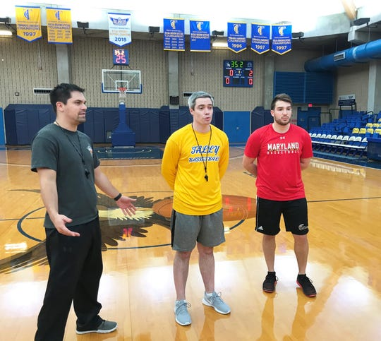 Zach Settembre (center) takes over as acting head coach for Mark White at Tallahassee Community College. He discusses strategy in practice with assistants Ben Mandelbaum (left) and Michael Caswell.