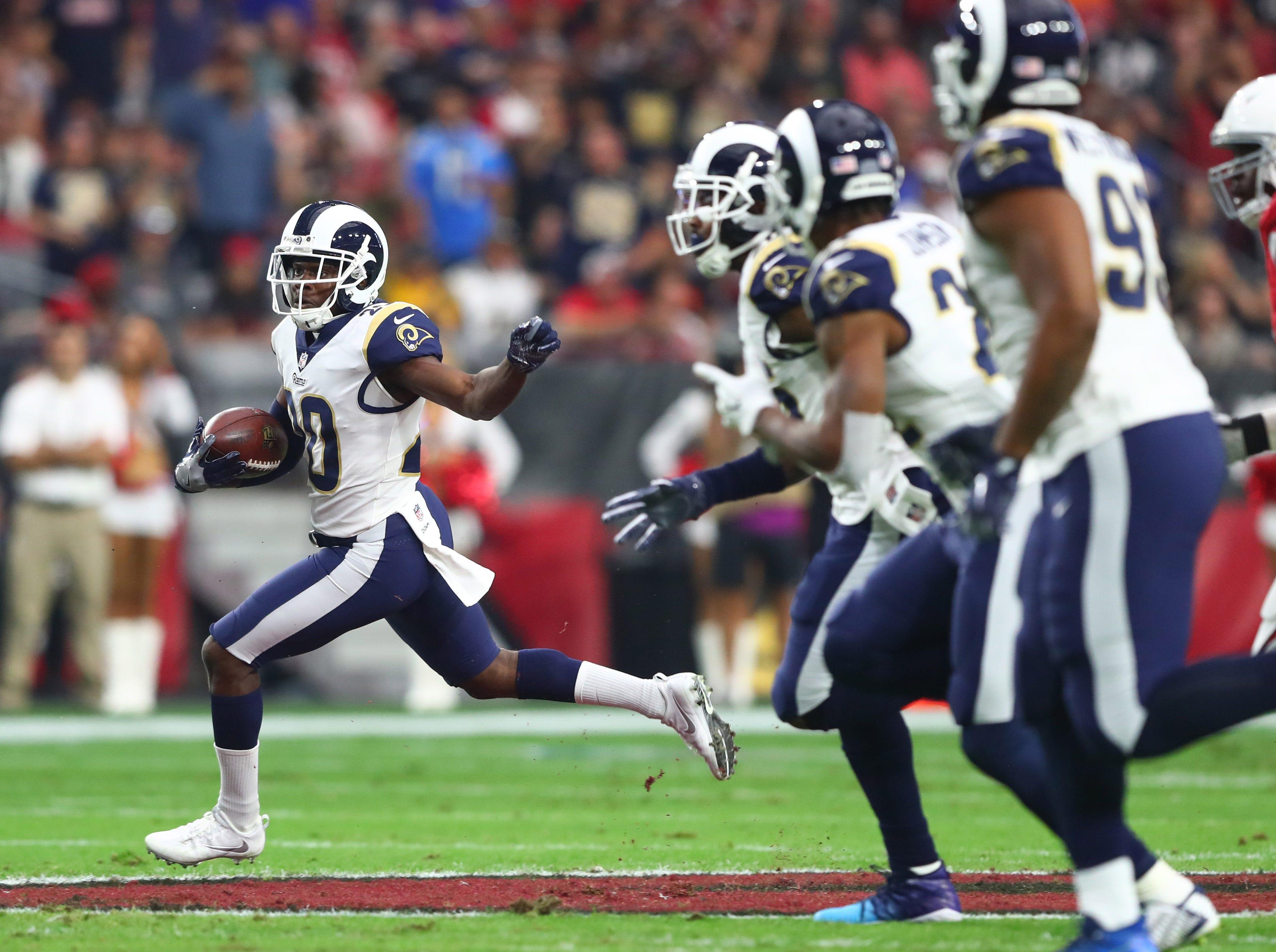 Dec 3, 2017; Glendale, AZ, USA; Los Angeles Rams safety Lamarcus Joyner returns a first quarter interception against the Arizona Cardinals at University of Phoenix Stadium. Mandatory Credit: Mark J. Rebilas-USA TODAY Sports