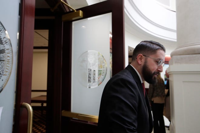 Tallahassee Mayoral candidate Dustin Daniels and former chief of staff to former Mayor and Democratic candidate for governor Andrew Gillum heads out of the courtroom where the Florida Commission on Ethics held probable cause hearings in separate cases filed against both Gillum and Daniels Friday, Jan. 25, 2019 at the First District Court of Appeals in Tallahassee.