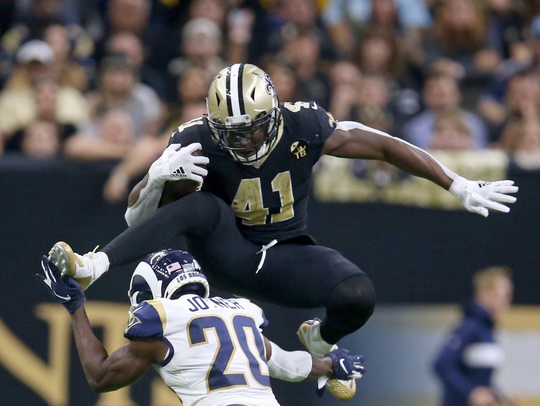 Nov 4, 2018; New Orleans, LA, USA; New Orleans Saints running back Alvin Kamara (41) hurdles Los Angeles Rams free safety Lamarcus Joyner (20) in the fourth quarter at the Mercedes-Benz Superdome. Saints won, 45-35. Mandatory Credit: Chuck Cook-USA TODAY Sports