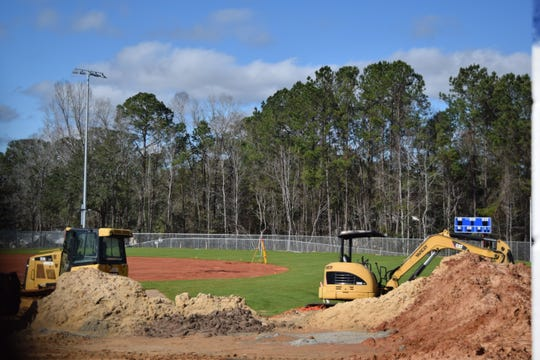 Construction crews are relocating the baseball and softball fields to Rickards High School as part of a $35-million renovation project.