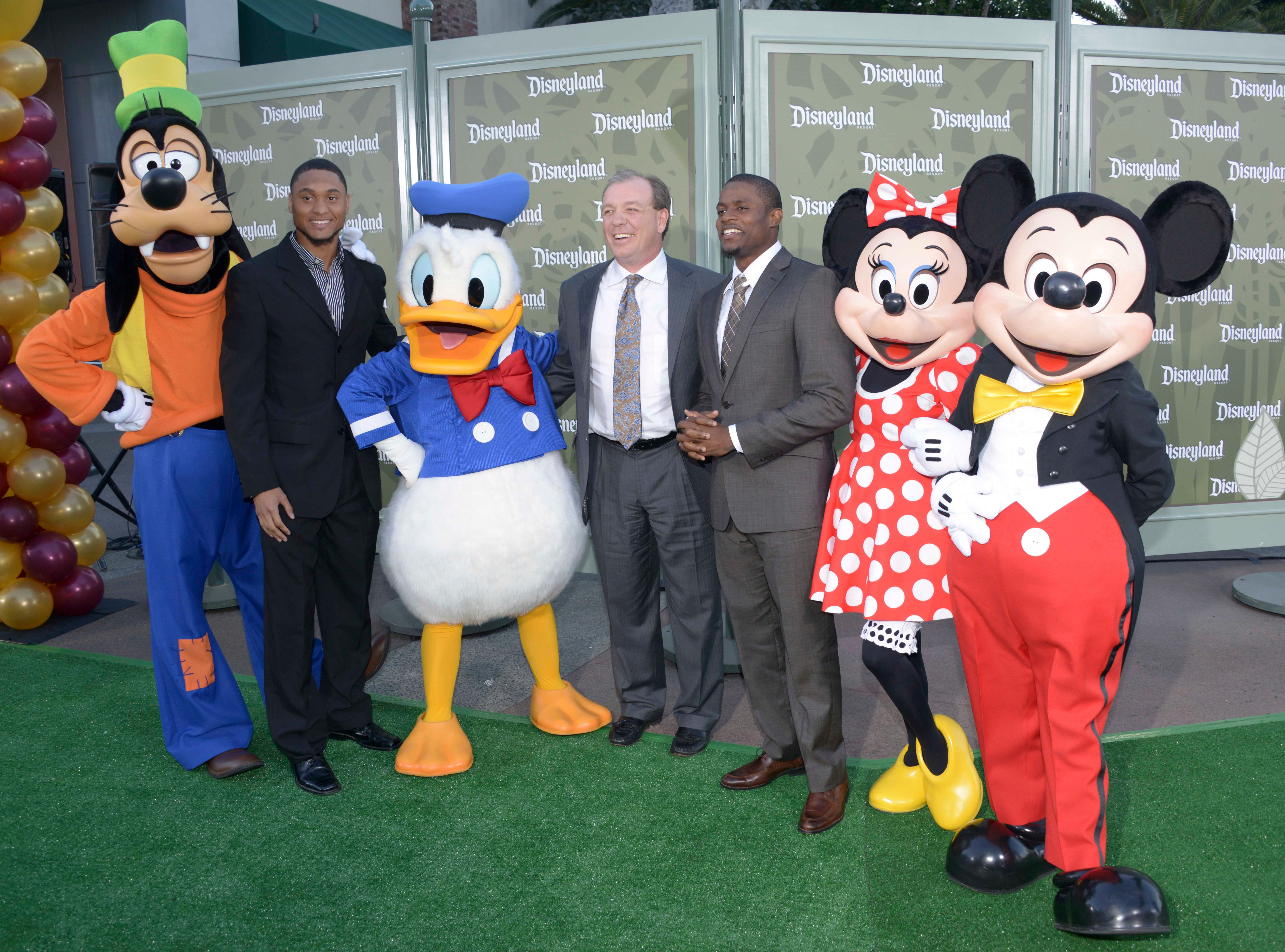 Dec 31, 2013; Anaheim, CA, USA; Florida State Seminoles players and coaches pose with Disney characters at a press conference for the 2014 BCS National Championship at ESPN Zone Downtown Disney. From left: Goofy and receiver Rashad Greene and Donald Duck and Jimbo Fisher and defensive back Lamarcus Joyner and Minnie Mouse and Mickey Mouse. Mandatory Credit: Kirby Lee-USA TODAY Sports