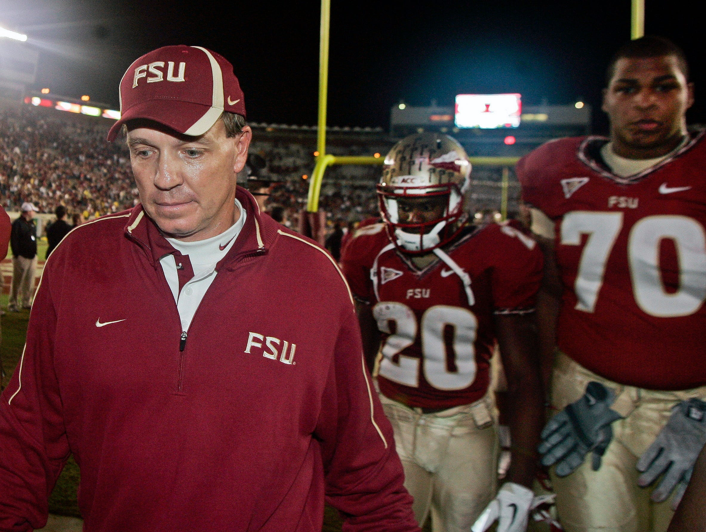 Nov 19, 2011; Tallahassee, FL, USA; Florida State Seminoles head coach Jimbo Fisher and safety Lamarcus Joyner (20) and offensive lineman Josue Matias (70) walk out after the game against the Virginia Cavaliers at Doak Campbell Stadium. Virginia won 14-13. Mandatory Credit: Phil Sears-USA TODAY Sports