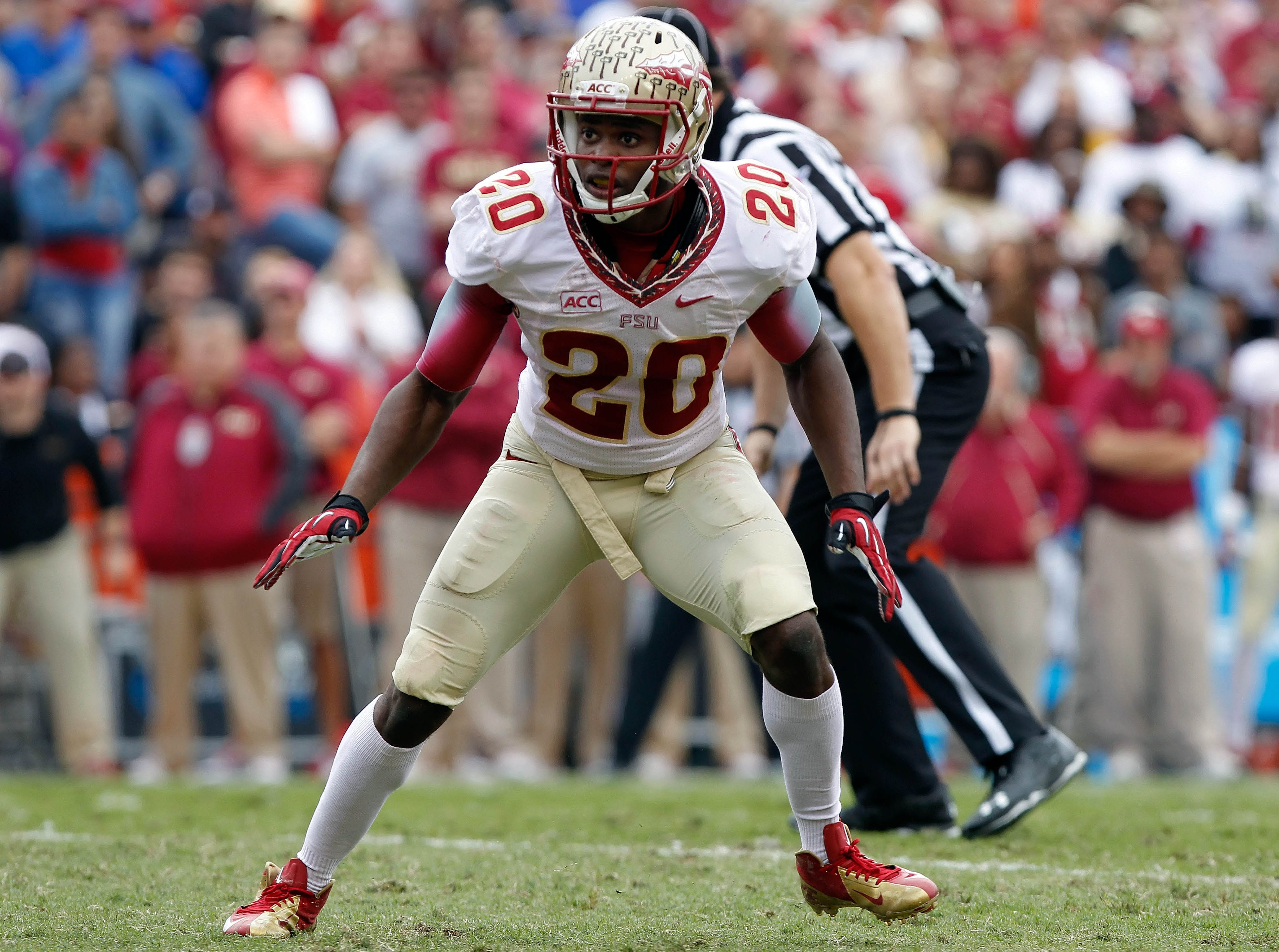 Nov 30, 2013; Gainesville, FL, USA; Florida State Seminoles defensive back Lamarcus Joyner (20) rushes during the first quarter against the Florida Gators at Ben Hill Griffin Stadium. Mandatory Credit: Kim Klement-USA TODAY Sports