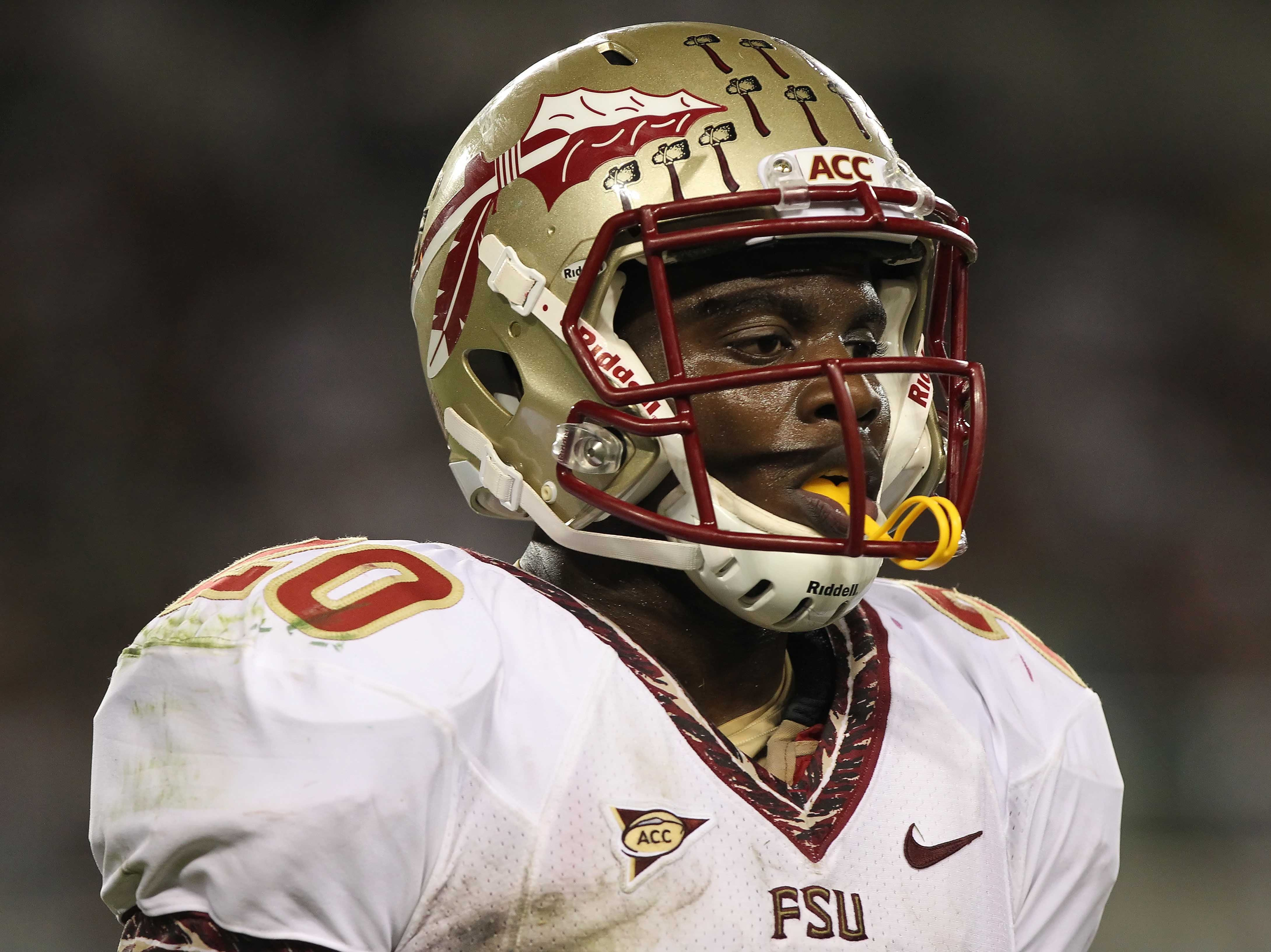 September 29, 2012; Tampa, FL, USA; Florida State Seminoles defensive back Lamarcus Joyner (20) against the South Florida Bulls during the second half at Raymond James Stadium. Florida State Seminoles defeated the South Florida Bulls 30-17. Mandatory Credit: Kim Klement-USA TODAY Sports