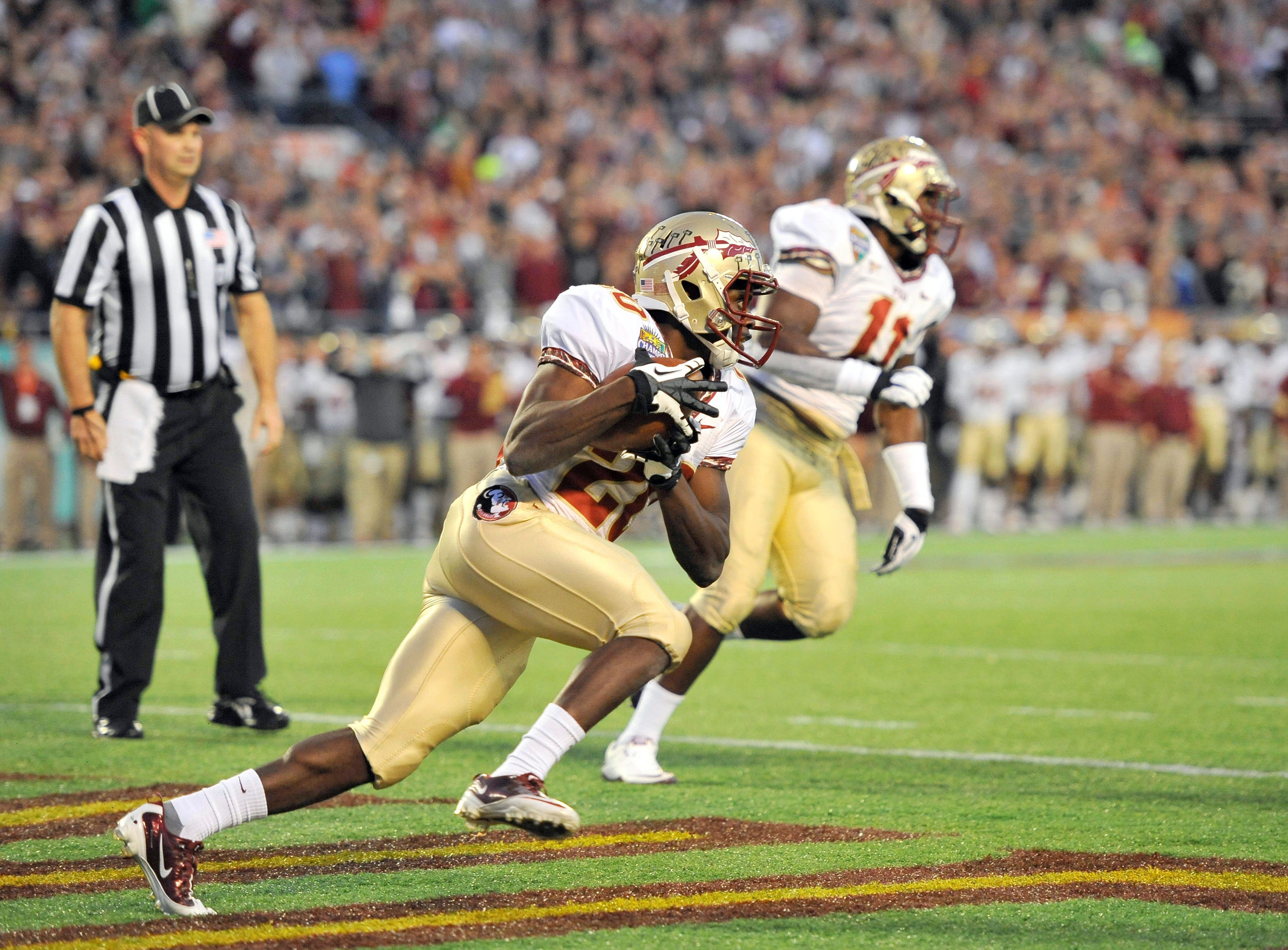December 29, 2011; Orlando, FL, USA;  Florida State Seminoles safety Lamarcus Joyner (20) makes the interception in the endzone and runs it out against the Notre Dame Fight Irish at the Champs Sports Bowl at Citrus Bowl. Mandatory Credit: Brad Barr-USA TODAY Sports